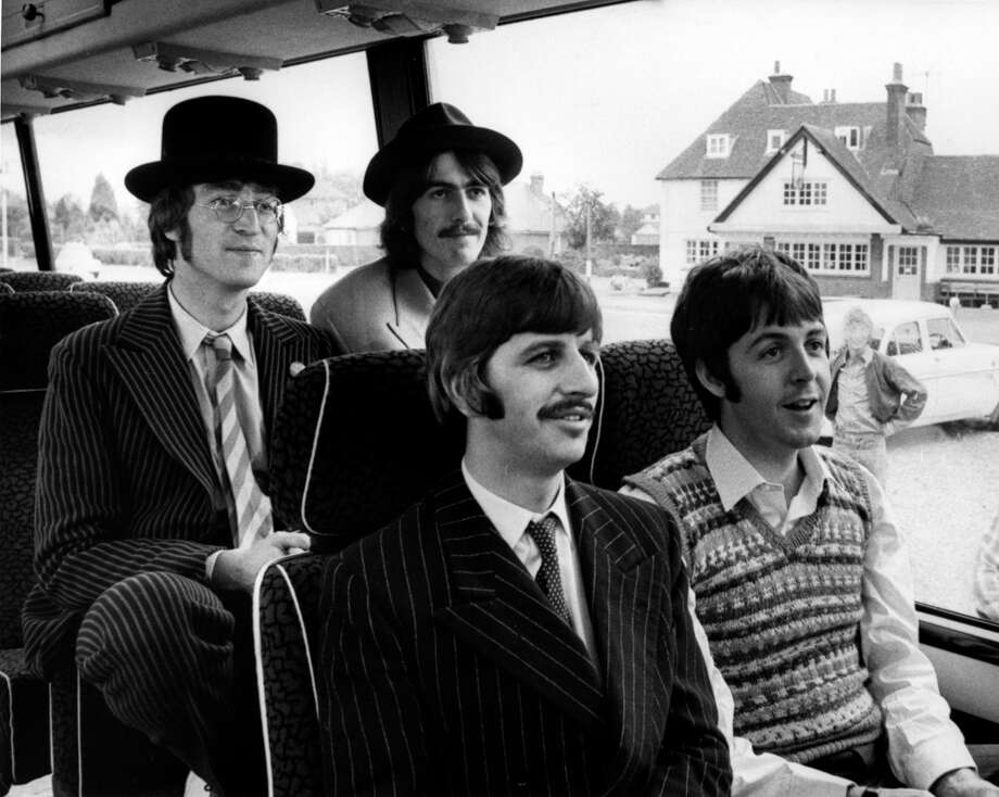 John Lennon, George Harrison, Ringo Starr, Paul McCartney - posed group shot, on bus, during filming of Magical Mystery Tour  (Photo by Cummings Archives/Redferns) Photo: Cummings Archives, Redferns / Redferns