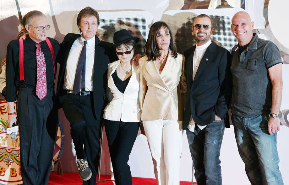 "Talk show host Larry King, Sir Paul McCartney, Yoko Ono, Olivia Harrison, Ringo Starr and Cirque du Soleil founder Guy Laliberte pose during a commemorative plaque dedication ceremony for John Lennon and George Harrison as part of the first anniversary celebration of ""The Beatles LOVE by Cirque du Soleil"" show at The Mirage Hotel & Casino June 26, 2007 in Las Vegas, Nevada.  (Photo by Ethan Miller/Getty Images) Photo: Ethan Miller, Getty Images"