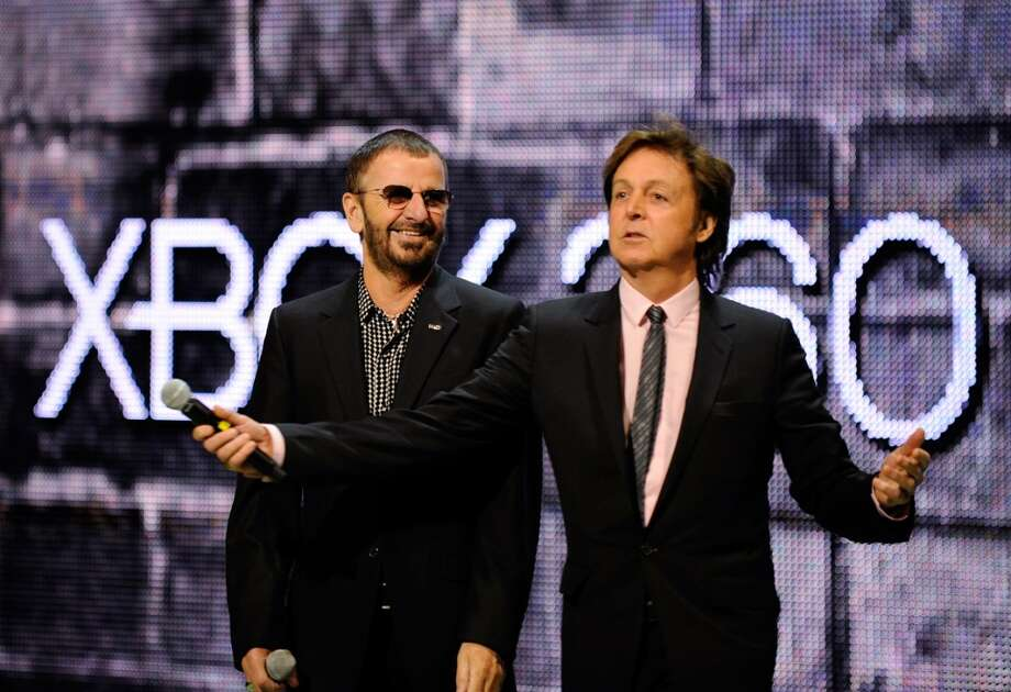 "Ringo Starr (L) and Sir Paul McCartney introduce the new video game ""The Beatles: Rock Band"" for the Microsoft  XBox 360 at the E3 2009 gaming expo on June 1, 2009 in Los Angeles, California. The Electronic Entertainment Expo (E3) is a three-day event dedicated to the gaming industry.    (Photo by Kevork Djansezian/Getty Images) Photo: Kevork Djansezian, Getty Images"