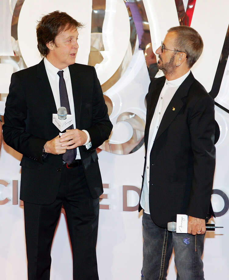 "Sir Paul McCartney and Ringo Starr speak at a commemorative plaque dedication ceremony for John Lennon and George Harrison as part of the first anniversary celebration of ""The Beatles LOVE by Cirque du Soleil"" show at The Mirage Hotel & Casino June 26, 2007 in Las Vegas, Nevada.  (Photo by Ethan Miller/Getty Images) Photo: Ethan Miller, Getty Images / 2007 Getty Images"