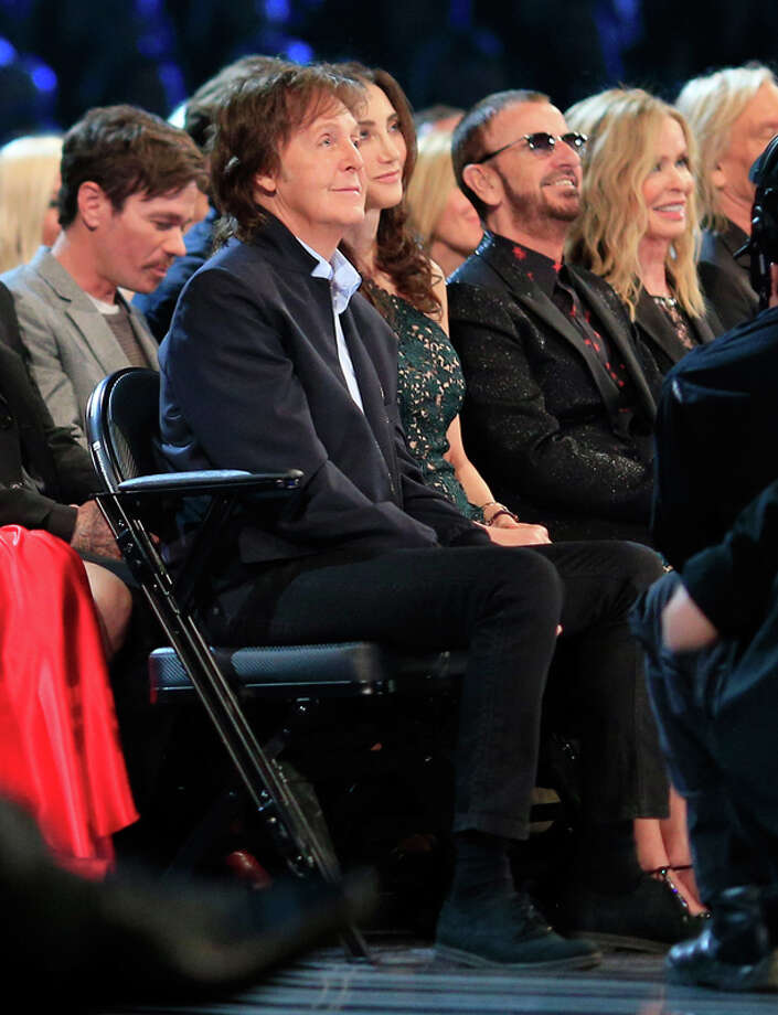 Musicians Sir Paul McCartney (L), Ringo Starr (second from left) and fellow audience members attend the 56th GRAMMY Awards at Staples Center on January 26, 2014 in Los Angeles, California.  (Photo by Christopher Polk/Getty Images) Photo: Christopher Polk, Getty Images / 2014 Getty Images