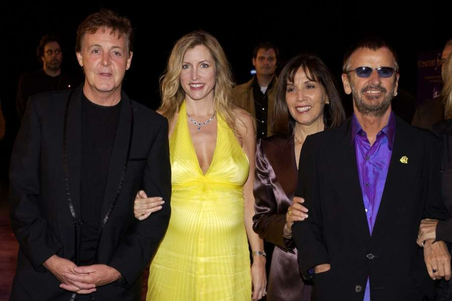 "Paul McCartney, Heather Mills, Olivia Harrison and Ringo Starr at the premiere of ""Concert for George,"" a new documentary film celebrating the music of George Harrison through performances by legendary musicians. (Photo by L. Cohen/WireImage) Photo: L. Cohen, WireImage"
