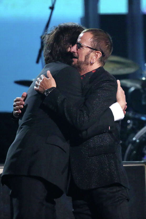 Paul McCartney, left, embraces Ringo Starr on stage at the 56th annual Grammy Awards at Staples Center on Sunday, Jan. 26, 2014, in Los Angeles. (Photo by Matt Sayles/Invision/AP) Photo: Matt Sayles, Matt Sayles/Invision/AP / AP2014