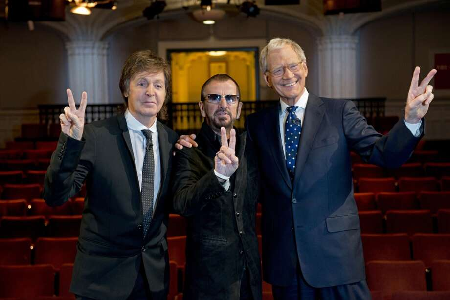 "In this Feb. 4, 2014 photo provided by CBS, surviving Beatles Paul McCartney, left and Ringo Starr, center, pose for a photo with talk show host David Letterman in the Ed Sullivan Theater, in New York. Letterman'€™s special interview with them will be featured in ""The Beatles: The Night That Changed America - A Grammy Salute,""€ that will air Sunday, Feb. 9 on CBS. (AP Photo/CBS, Jeffrey R. Staab) Photo: Jeffrey R. Staab, AP"