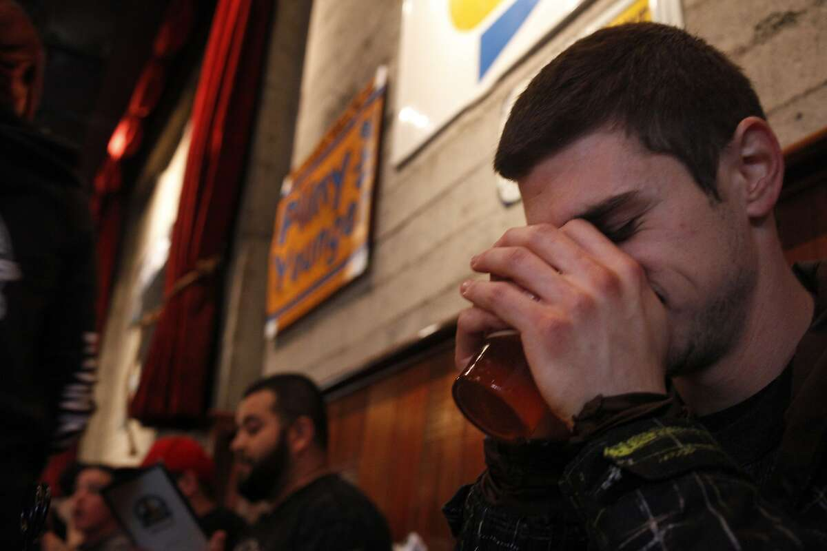 Brandon Frankel take a big whiff of the new Pliny the Younger Ale, as he tastes it for the first time at the Russian River Brewing Company, Friday February 7, 2014, in Santa Rosa, Calif. Frankel, 25 year-old, drove up from Los Angeles to pick up his buddy Bowman Chaney and celebrated their birthdays by being the first in line to taste the much anticipated beer.