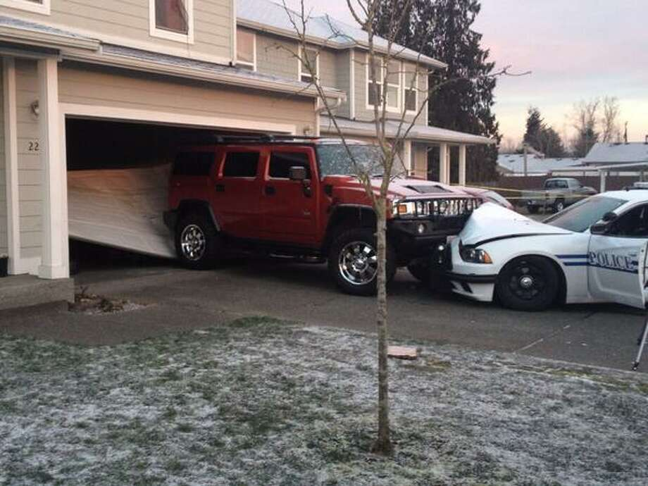 A man was shot by Pacific police during an attempt to steal a patrol car Thursday night, which ultimately crashed into a hummer outside a house. Photo by King County Sheriff's Office Photo: King County Sheriff's Office