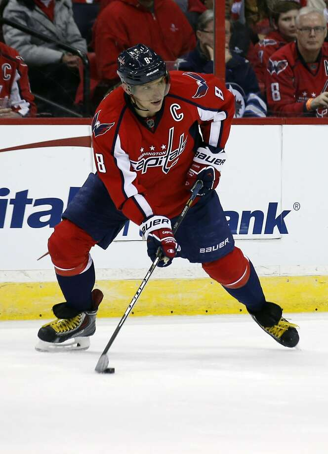 Capitals star Alex Ovechkin, who leads the NHL with 40 goals, will lead the Russian Federation team in Sochi. Photo: Alex Brandon, Associated Press