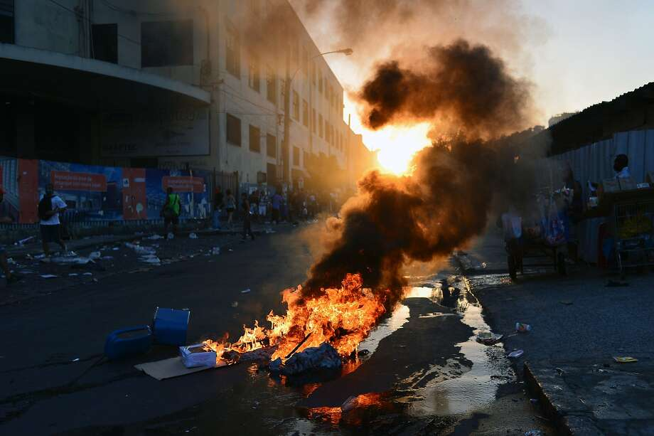 Flame it on Rio:In Rio de Janeiro, protesters set a street on fire to show their displeasure at the city's decision to raise bus fare by 25 cents. Photo: Yasuyoshi Chiba, AFP/Getty Images