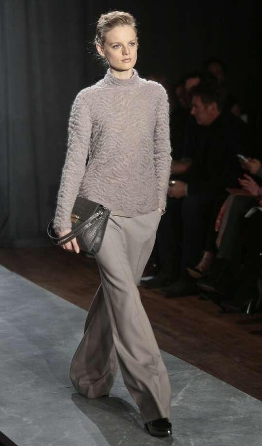 Fashion from the Jason Wu Fall 2014 collection is modeled, during New York Fashion Week on Friday Feb. 7, 2014.  (AP Photo/Bebeto Matthews) Photo: Bebeto Matthews, Associated Press