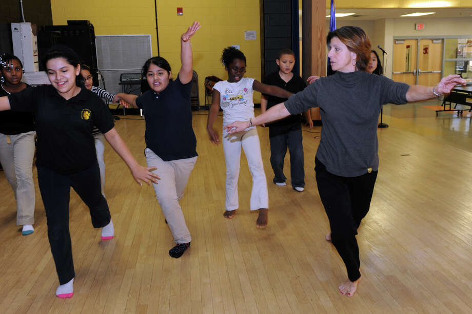 Claire Mastromonaco, a fifth grade teacher at Johnson School, leads the afterschool dance class that she gives for students in Bridgeport, Conn. Feb. 6, 2014. Mastromonaco wants to start a new all girls science and math charter school called STEAM. Photo: Ned Gerard / Connecticut Post