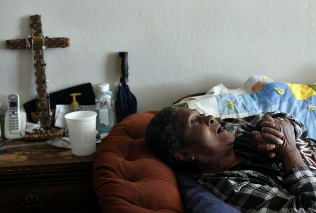 Geneva Eaton lays on her couch after having a sleepless night, Thursday October 10, 2013, in her apartment at Hacienda Public Housing Complex in Richmond, Calif. She goes to bed with the lights on, afraid that the vermin she hears chewing through her walls will bite her in her sleep. Her apartment is infested with cockroaches and mice, and after months of personally beseeching top housing authority officials to clean her home, she has given up. ÒThey all so crooked, who even wants to try anymore,Ó she said. ÒI wanna go someplace else, but I donÕt have anywhere else to go.Ó Photo: Lacy Atkins, The Chronicle