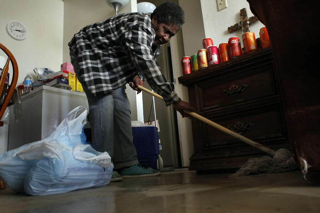 Geneva Eaton mops her floors as she cleans. Photo: Lacy Atkins, The Chronicle