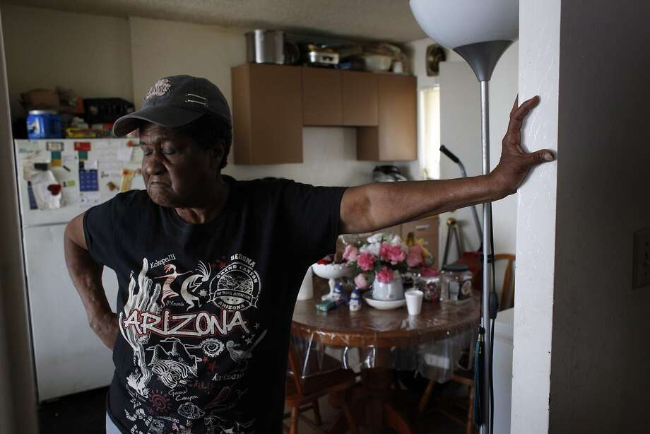 Geneva Eaton stands in the kitchen of her apartment in the Hacienda housing project, reciting problems including the stench of mold, lack of heat and mice. Photo: Lacy Atkins, The Chronicle