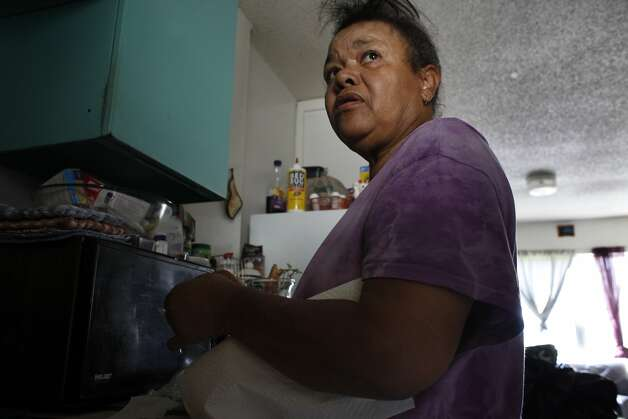 Anna Threadgill keeps a jar of bedbugs in her kitchen to show to the Housing Authority maintenance workers,  Tuesday October 8, 2013, in the Hacienda Public Housing Complex in Richmond, Calif. Even with the proof exterminators never come. Photo: Lacy Atkins, The Chronicle