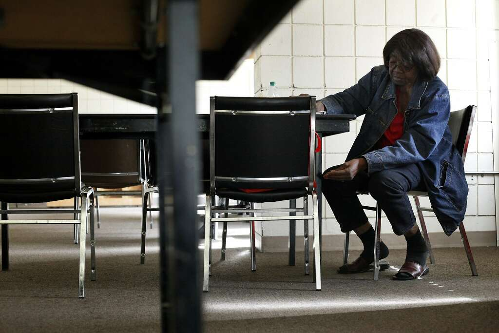 Helen Hall, 81, sits at folding table next to the vending machines in the   common room of Nevin Pla. Photo: Lacy Atkins, The Chronicle