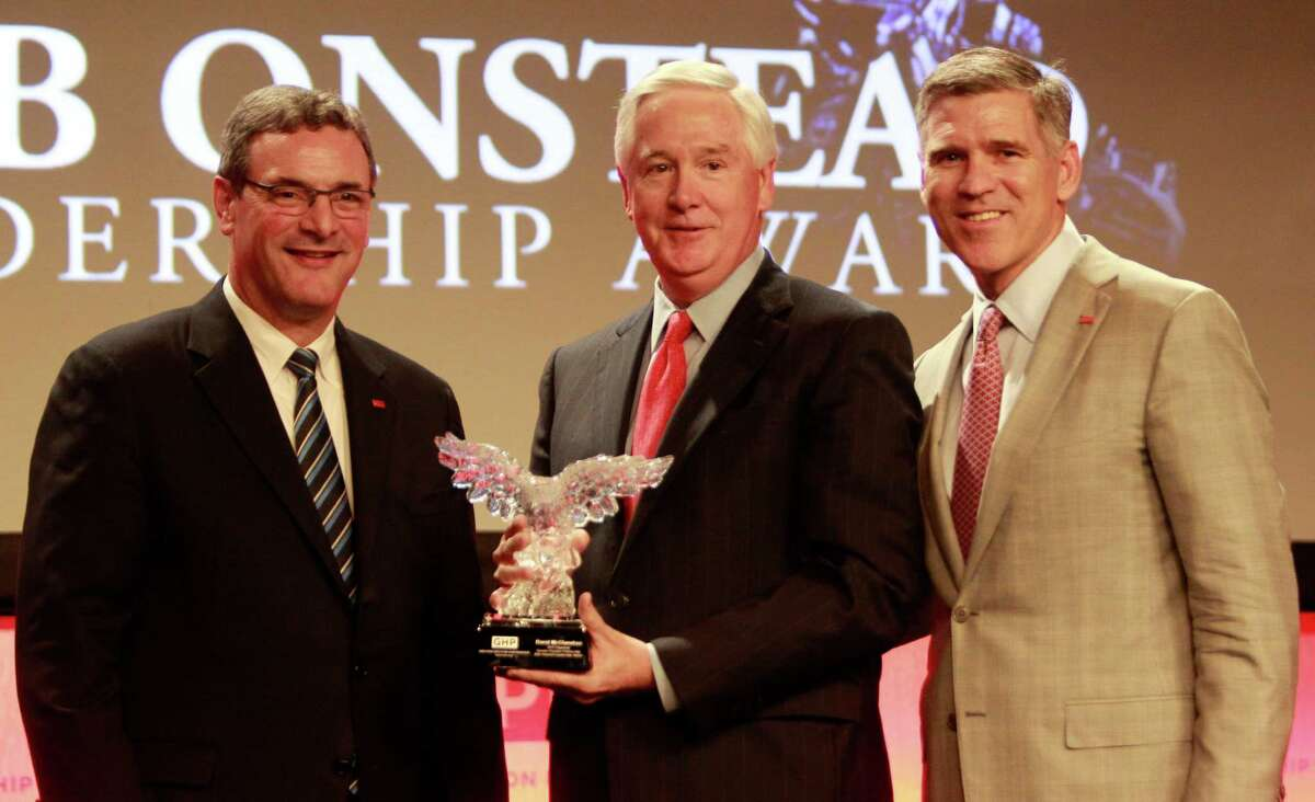 Bob Harvey, left, Greater Houston Partnership president and CEO, David McClanahan, center, the 2013 chairman of the GHP,and Paul W. Hobby, right, the 2014 chairman of the GHP, pose for photographs after McClanahan was presented with the Bob Onstead Award during the GHP annual meeting held at the Hilton Americas, 1600 Lamar, Wednesday, Feb. 5, 2014, in Houston. ( Melissa Phillip / Houston Chronicle )