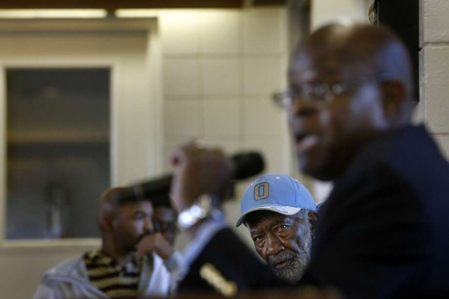 Public housing resident John Oliver, 76, watches Housing Authority chief Tim Jones speak to the advisory commission. Photo: Lacy Atkins, The Chronicle