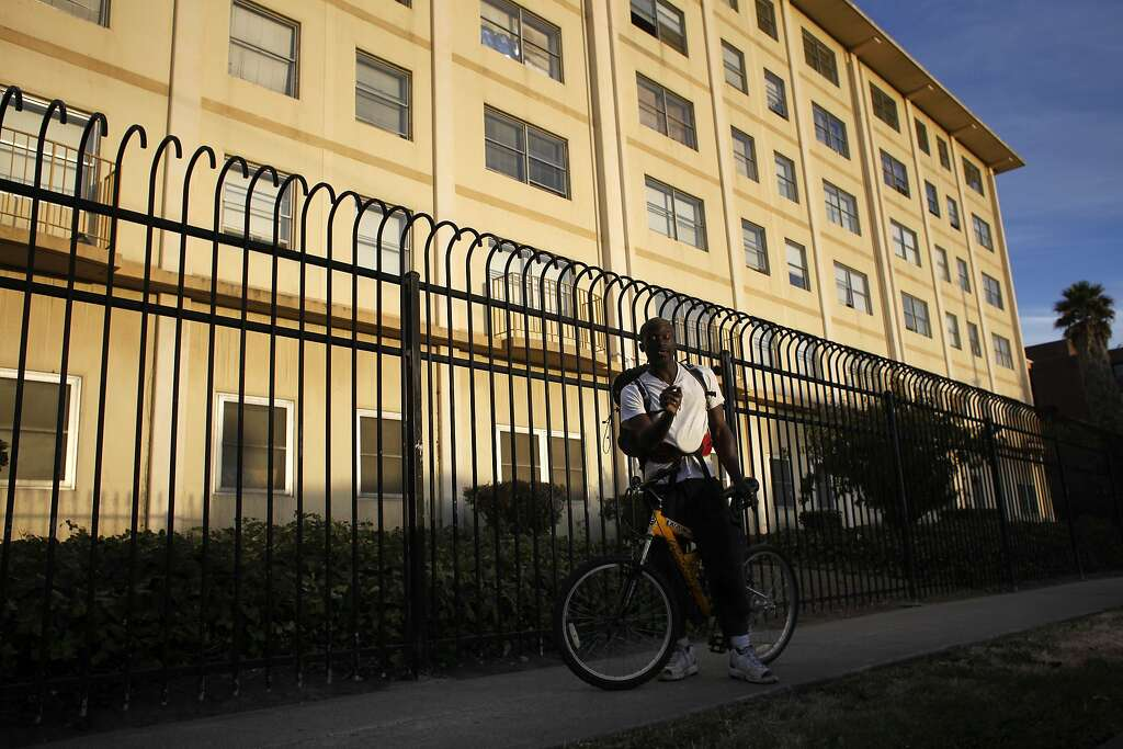 Steven Muccular rides his bike to visit his family at the Hacienda Public Housing Complex, Monday Oc. Photo: Lacy Atkins, The Chronicle
