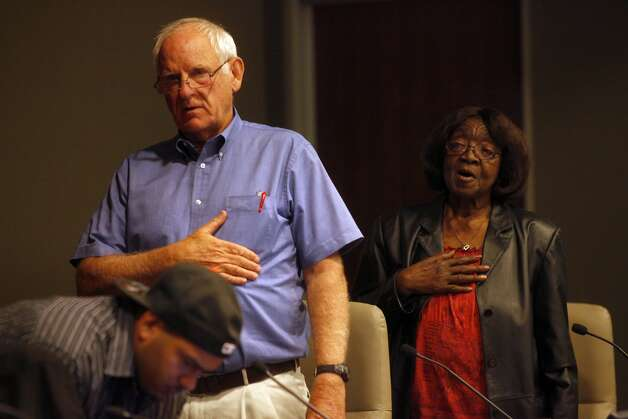 Helen Hall, 81, right, recites the pledge of allegiance at the Richmond City Council Meeting before addressing the council about the living conditions at Nevin Plaza Public Housing, Thursday, October 17, 2013, in Richmond, Calif. Photo: Lacy Atkins, The Chronicle