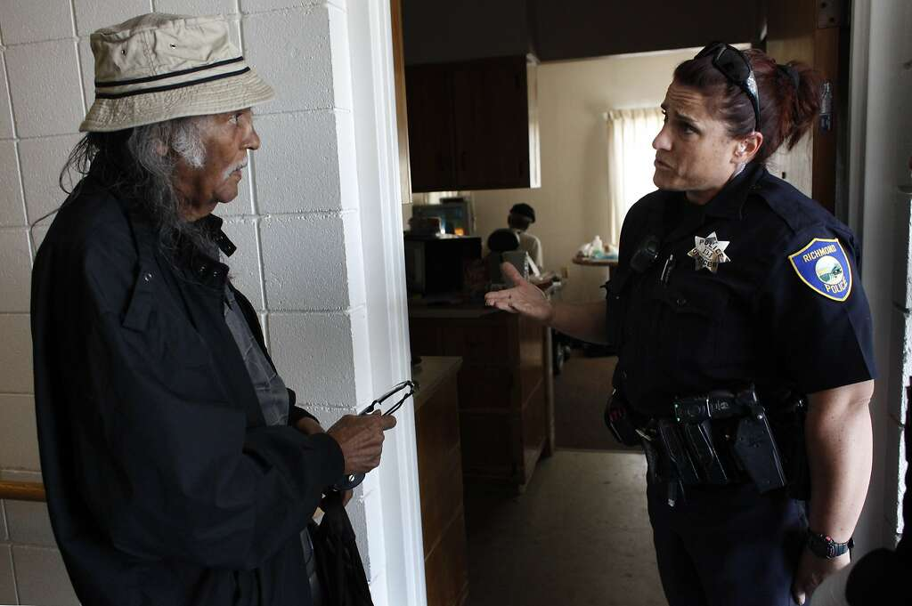 Cleon Harvey talks with Richmond Police Officer Giulia Colbacchini about getting more care for his b, The Chronicle