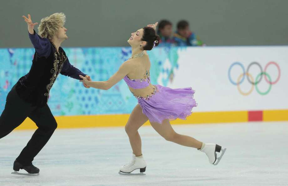 Meryl Davis and Charlie White of the United States skate at the figure skating practice rink ahead of the 2014 Winter Olympics, Wednesday, Feb. 5, 2014, in Sochi, Russia. (AP Photo/Ivan Sekretarev) ORG XMIT: OLYIS106 Photo: Ivan Sekretarev / AP