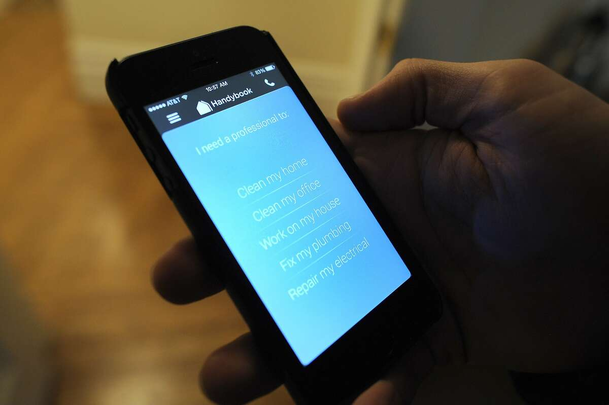Tristan Zier of Handybook shows his company's app that allows users to order house cleaners, handymen, electritions, and plumbers online, at his home in San Francisco, CA Friday, February 7, 2014.