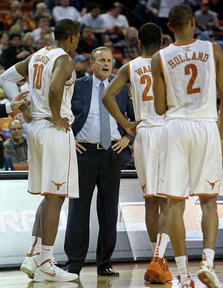 UT coach Rick Barnes, center, has rallied the troops during Big 12 action. His No. 15 team is on a seven-game win streak, including four over ranked foes. Photo: TOM REEL, Staff / San Antonio Express-News