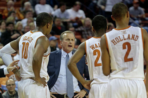UT coach Rick Barnes, center, has rallied the troops during Big 12 action. His No. 15 team is on a seven-game win streak, including four over ranked foes.