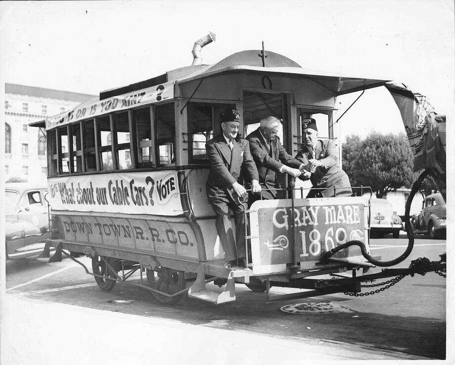 Mayor Roger Lapham (center) drove a horsecar down Market Street to poke  fun at antiquated cable cars during the campaign to scrap them.