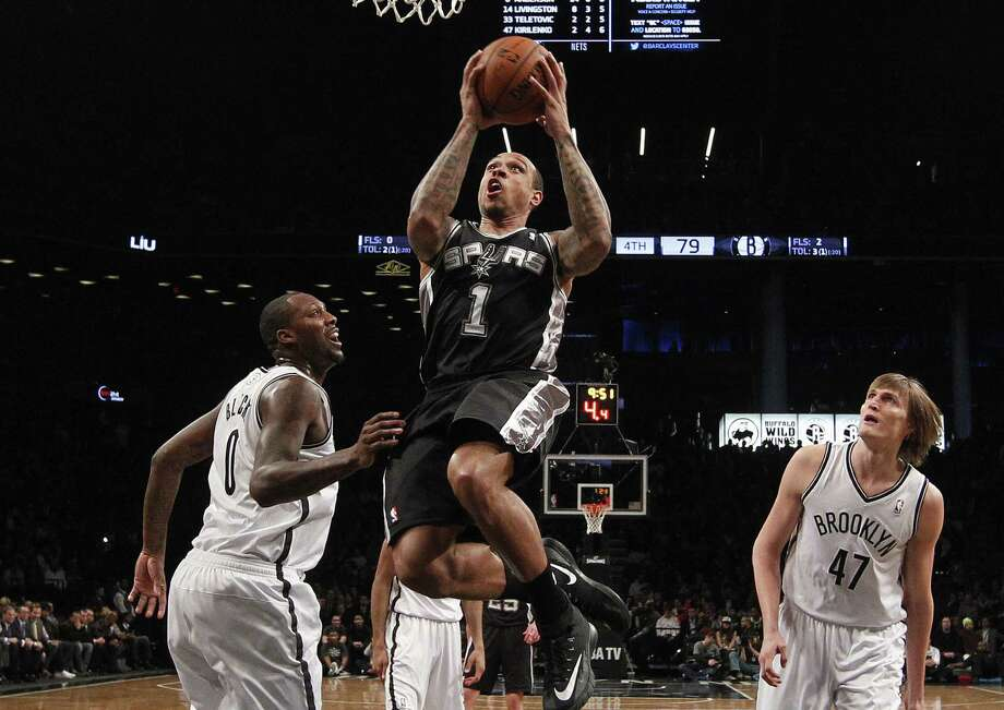 Veteran guard Shannon Brown, going to the basket in Thursday night's loss at Brooklyn, is doing everything he can to earn another 10-day contract from the injury-riddled Spurs. Photo: Jason DeCrow / Associated Press / FR103966 AP