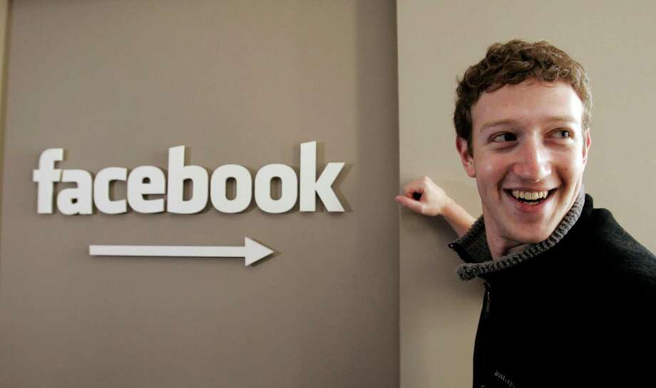 FILE- This Feb. 5, 2007 file photo shows Facebook.com founder Mark Zuckerberg smiling at Facebook headquarters in Palo Alto, Calif.  On Feb. 4, 2014, Facebook celebrates 10 years since Mark Zuckerberg created a website called Thefacebook.com to let his classmates find their friends online.( AP Photo/Paul Sakuma,File) Photo: Associated Press / AP