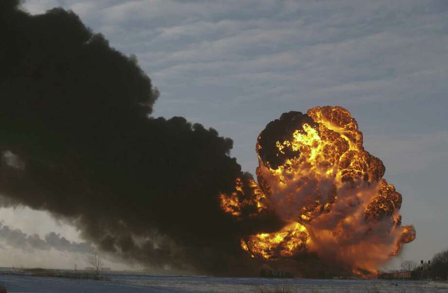 A fireball goes up at the site of an oil train derailment in Casselton, N.D., in December. U.S. and Canadian accident investigators warned at the time about dangers in transporting large amounts of crude oil. Photo: Associated Press / File Photo / FR6524 AP