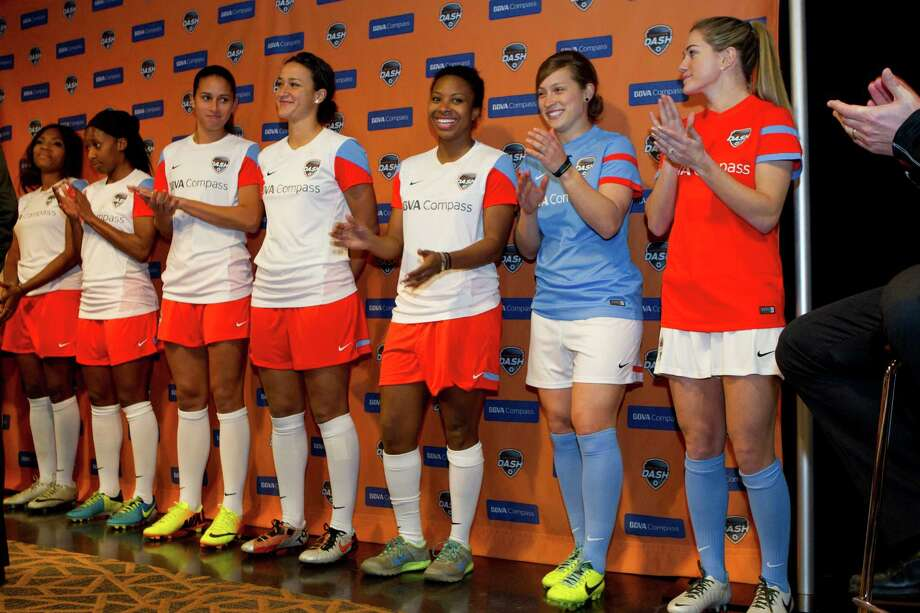 Houston Dash players show off the team's new uniforms as they are unveiled during a news conference at BBVA Compass Stadium Friday, Feb. 7, 2014, in Houston. The Dash, the National Women's Soccer League's newest team, open its inaugural season on April 12, at BBVA Compass Stadium against the Portland Thornes. Photo: Brett Coomer, Houston Chronicle / © 2014 Houston Chronicle