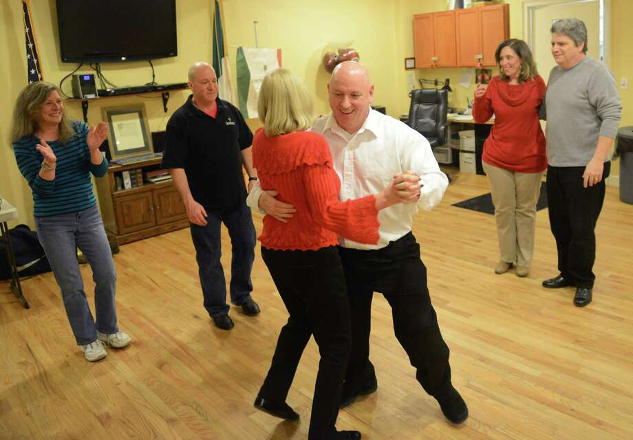 Mike Daubert and Barbara Williams, of Bethel, dance in the center of the group at the Irish dance class at the Irish Cultural Center in Danbury, Conn. Friday, Feb. 7, 2014.  The center holds instructional dance classes the first and third Friday of every month, teaching the basics of Irish partners set dancing.  Once a month, the Irish Cultural Center has a large dance, called a Ceili, featuring live music. Photo: Tyler Sizemore / The News-Times