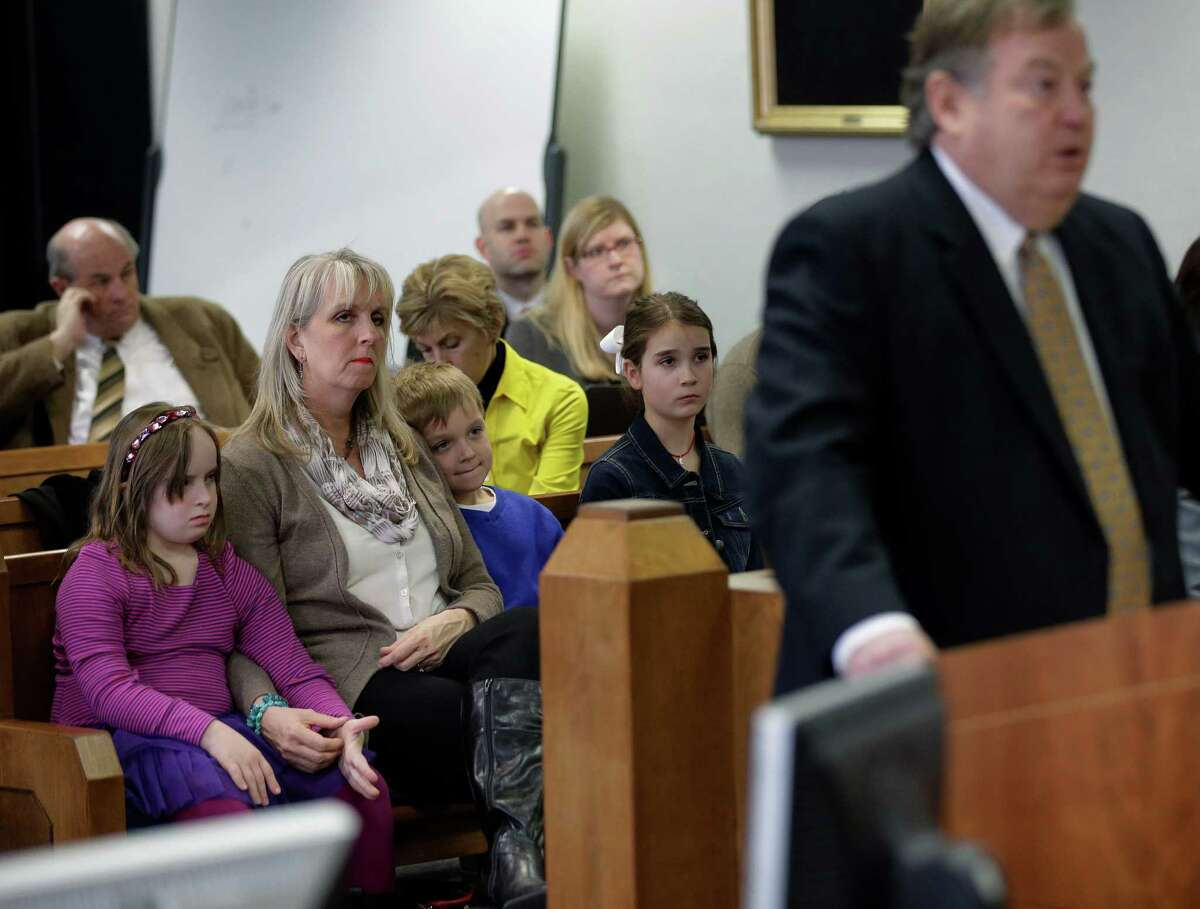 Attendees listen to plaintiff attorney Richard Gray, right, makes his closing arguments in the second phase of Texas' school finance trial.
