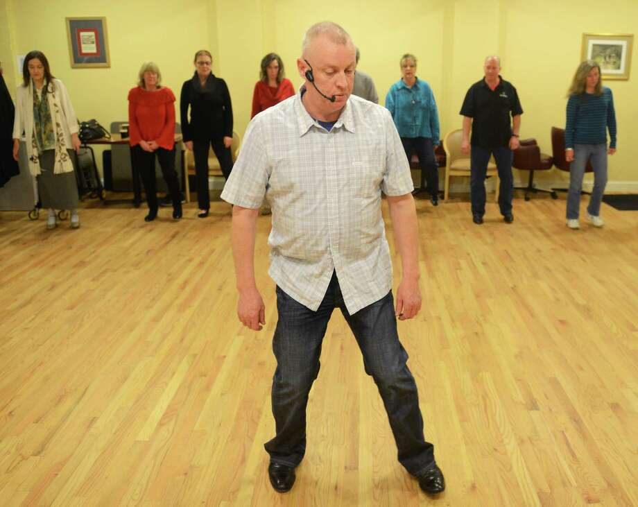 Dance instructor Fergal O'Halloran teaches the Irish dance class at the Irish Cultural Center in Danbury, Conn. Friday, Feb. 7, 2014.  The center holds instructional dance classes the first and third Friday of every month, teaching the basics of Irish partners set dancing.  Once a month, the Irish Cultural Center has a large dance, called a Ceili, featuring live music. Photo: Tyler Sizemore / The News-Times