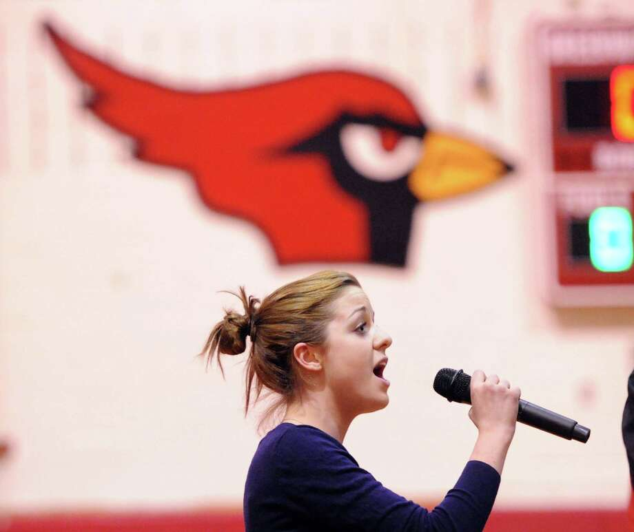 Greenwich High School junior Natalie Anibal, 16, sings the National Anthem at the start of the boys high school basketball game between Warren Harding High School and Greenwich High School at Greenwich, Friday night, Feb. 7, 2014. Photo: Bob Luckey / Greenwich Time
