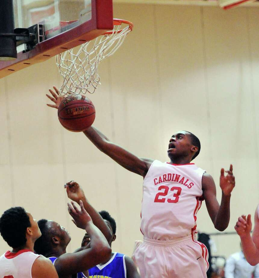Leonel Hyatt (#23) of Greenwich goes high for a rebound during the boys high school basketball game between Warren Harding High School and Greenwich High School at Greenwich, Friday night, Feb. 7, 2014. Photo: Bob Luckey / Greenwich Time