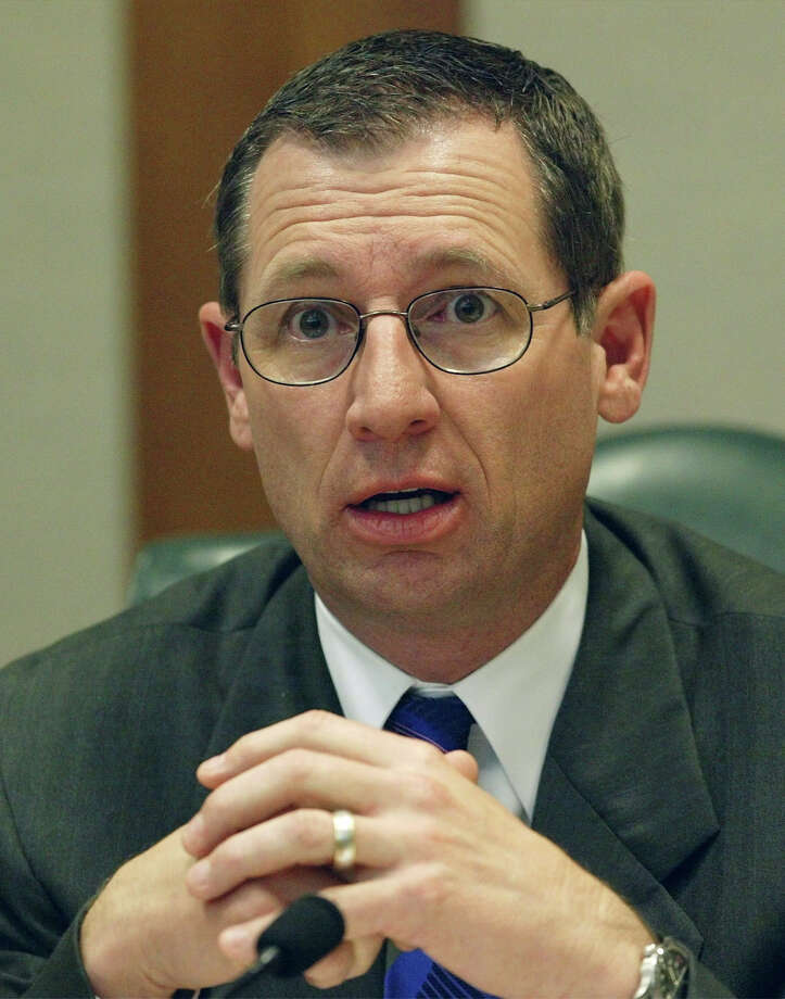 Rep. Byron Cook, R-Corsicana, questions a witness during a hearing by members of the House Ways and Means Committee on Wednesday, March 2, 2005, in Austin, Texas. The tax-writing committee is charged with finding other revenue that would allow for a one-third reduction in school property taxes. Rep. Cook is not a member of the committee, but was permitted to sit in during the meeting.  (AP Photo/Harry Cabluck) Photo: HARRY CABLUCK, STF / AP