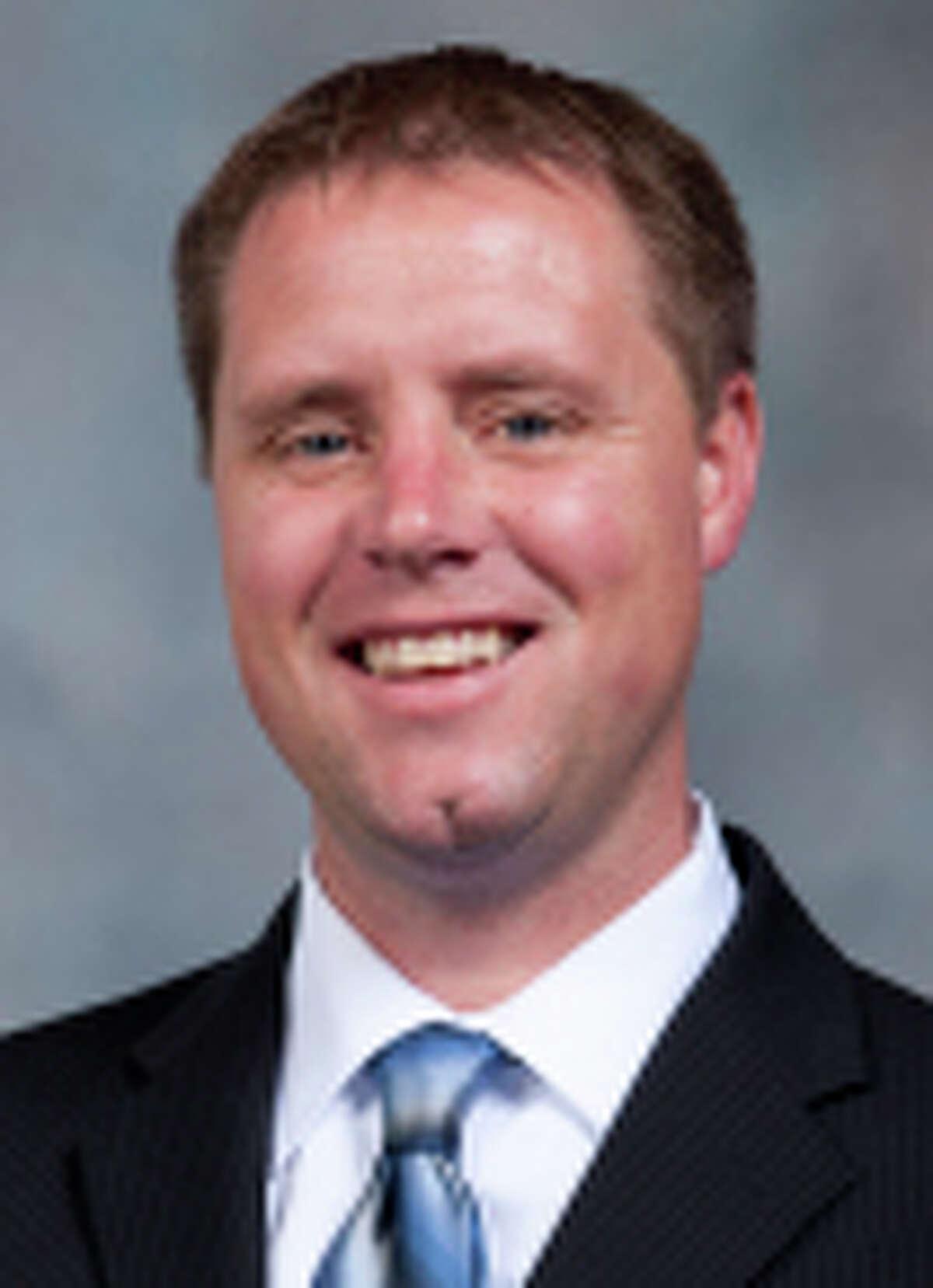 Billy Lynch rice football mug 2014 VP Public Affairs