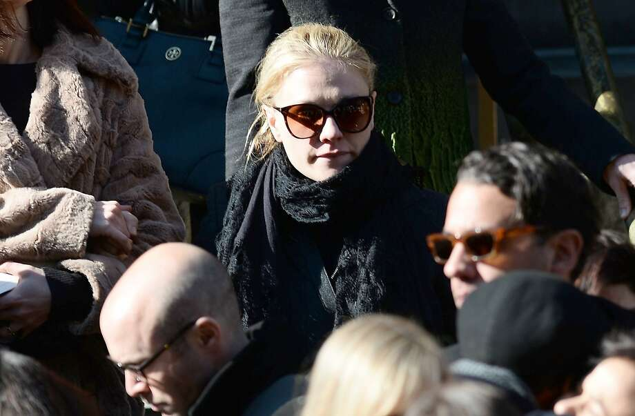 Actress Anna Paquin leaves after attending Philip Seymour Hoffman's funeral at St. Ignatius of Loyola Church in New York, February 6, 2014.  Friends and relatives of Oscar-winning actor Philip Seymour Hoffman gathered in New York for his private funeral Friday, five days after he was found dead of a suspected overdose. The mass was closed to the public and press at the Church of  St. Ignatius Loyola on Park Avenue, which also held the 1994 funeral of Jacqueline Kennedy Onassis, the wife of assassinated US president John F. Kennedy. AFP PHOTO/Emmanuel DunandEMMANUEL DUNAND/AFP/Getty Images Photo: Emmanuel Dunand, AFP/Getty Images