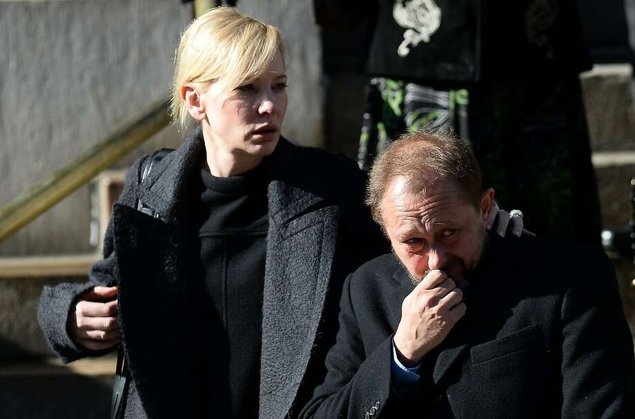 Actress Cate Blanchett and her husband Andrew Upton leave after attending Philip Seymour Hoffman's funeral at St. Ignatius of Loyola Church in New York, February 6, 2014.  Friends and relatives of Oscar-winning actor Philip Seymour Hoffman gathered in New York for his private funeral Friday, five days after he was found dead of a suspected overdose. The mass was closed to the public and press at the Church of  St. Ignatius Loyola on Park Avenue, which also held the 1994 funeral of Jacqueline Kennedy Onassis, the wife of assassinated US president John F. Kennedy. AFP PHOTO/Emmanuel DunandEMMANUEL DUNAND/AFP/Getty Images Photo: Emmanuel Dunand, AFP/Getty Images