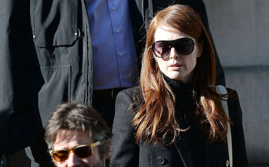 Actress Julianne Moore leaves after attending Philip Seymour Hoffman's funeral at St. Ignatius of Loyola Church in New York, February 6, 2014.  Friends and relatives of Oscar-winning actor Philip Seymour Hoffman gathered in New York for his private funeral Friday, five days after he was found dead of a suspected overdose. The mass was closed to the public and press at the Church of  St. Ignatius Loyola on Park Avenue, which also held the 1994 funeral of Jacqueline Kennedy Onassis, the wife of assassinated US president John F. Kennedy. AFP PHOTO/Emmanuel DunandEMMANUEL DUNAND/AFP/Getty Images Photo: Emmanuel Dunand, AFP/Getty Images