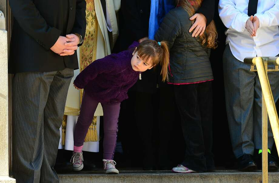 Willa,5, the youngest daughter of late actor Philip Seymour Hoffman, looks as her dad's casket is loaded onto a hearse following his funeral at St. Ignatius of Loyola Church in New York, February 7, 2014. AFP PHOTO/Emmanuel DunandEMMANUEL DUNAND/AFP/Getty Images Photo: Emmanuel Dunand, AFP/Getty Images