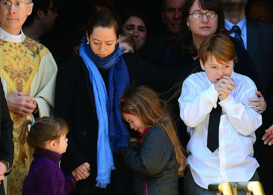 US actor Philip Seymour Hoffman's estranged partner  Mimi O'Donnell(C) with their children, Cooper Hoffman(R), Willa Hoffman(L) and Tallulah Hoffman watch his casket leaving at the end of his funeral at St. Ignatius of Loyola Church in New York, February 6, 2014.  Friends and relatives of Oscar-winning actor Philip Seymour Hoffman gathered in New York for his private funeral Friday, five days after he was found dead of a suspected overdose. The mass was closed to the public and press at the Church of  St. Ignatius Loyola on Park Avenue, which also held the 1994 funeral of Jacqueline Kennedy Onassis, the wife of assassinated US president John F. Kennedy. TOPSHOTS/AFP PHOTO/Emmanuel DunandEMMANUEL DUNAND/AFP/Getty Images Photo: Emmanuel Dunand, AFP/Getty Images