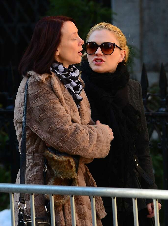 Actress Anna Paquin(R) arrives to attend Philip Seymour Hoffman's funeral at St. Ignatius of Loyola Church in New York, February 6, 2014.  Friends and relatives of Oscar-winning actor Philip Seymour Hoffman gathered in New York for his private funeral Friday, five days after he was found dead of a suspected overdose. The mass was closed to the public and press at the Church of  St. Ignatius Loyola on Park Avenue, which also held the 1994 funeral of Jacqueline Kennedy Onassis, the wife of assassinated US president John F. Kennedy. AFP PHOTO/Emmanuel DunandEMMANUEL DUNAND/AFP/Getty Images Photo: Emmanuel Dunand, AFP/Getty Images