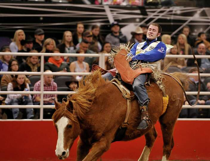 Kaycee Feild rides during the bareback competition of the San Antonio rodeo on Friday, Feb. 7, 2014,