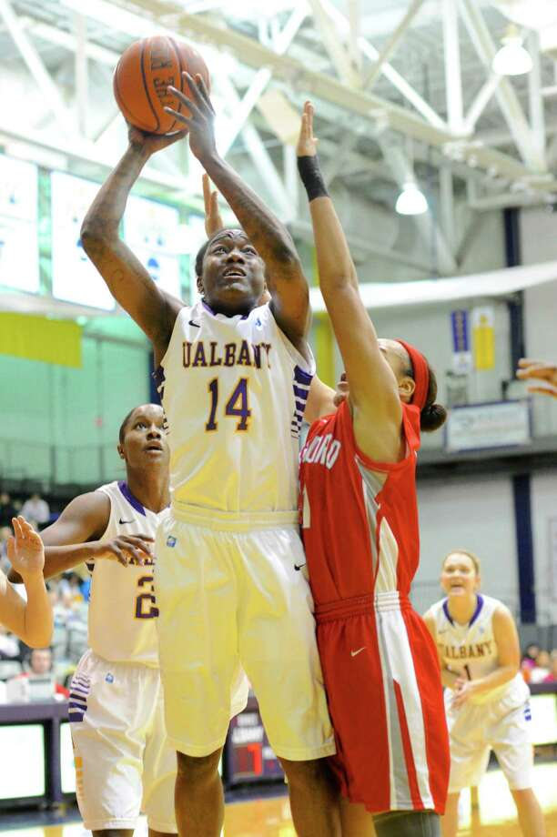UAlbany's Tammy Phillip drives in for a basket in first-half action in UAlbany's easy victory over Hartford on Friday, Feb. 7, 2014. (Bob Mayberger / Special to the Times Union) Photo: BOB MAYBERGER     PHOTOGRAPHY