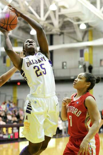 UAlbany's Shereesha Richards drives in for a basket in first-half action in UAlbany's easy victory o