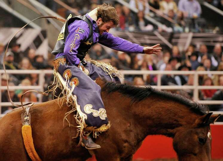 Tilden Hooper rides during the bareback competition of the San Antonio rodeo on Friday, Feb. 7, 2014